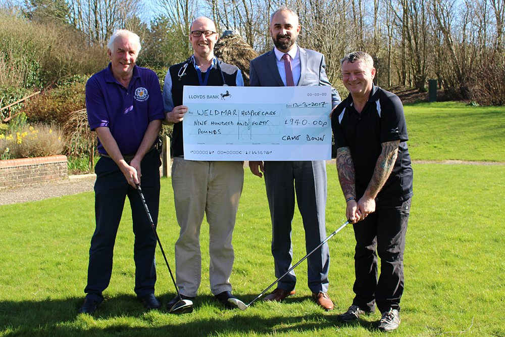 Representatives from Came Down Golf Club present a cheque to Weldmar