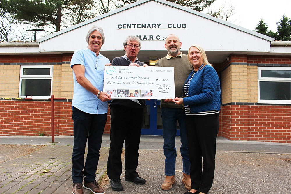 Chris Dean, Paul Ward and Simon Brakespear present a cheque for £2,600 to Diane Bentley