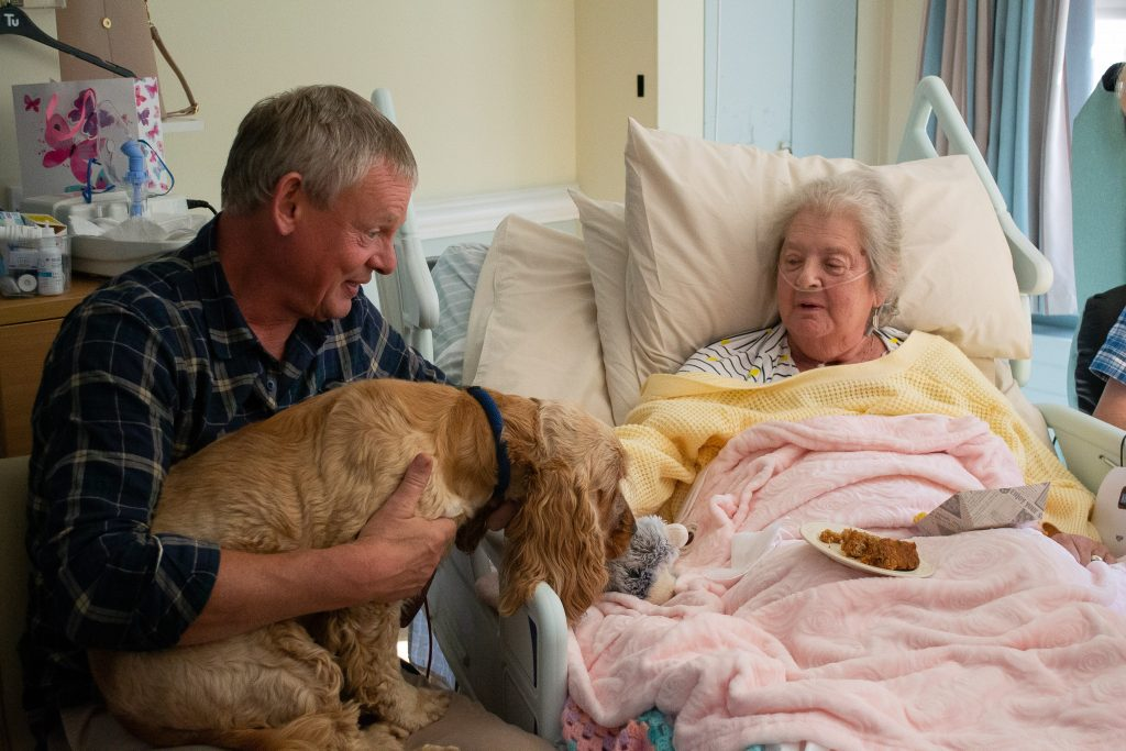 Martin Clunes and patient at Weldmar Hospicecare Trust charity in Dorset.
